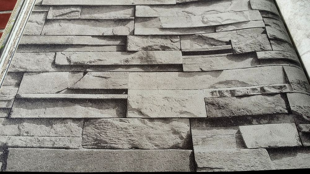Carta da parati legno mattoni pietra for Carta parati grigia